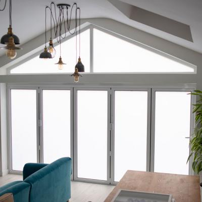 Residential bifold doors in electric privacy glass